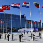 Nato began a 12-week staged move to new headquarters